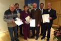 Feldgeschworener und Kommunalpolitiker erhalten Urkunden und Medaillen